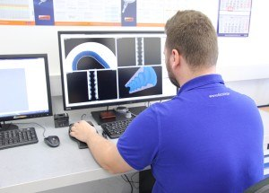 Quality Assurance employee performing a stator check using a measuring device based on computed tomography technology