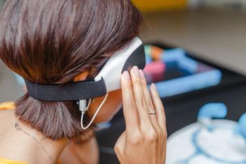 Digital headwear equipment sensor connected to the ear.