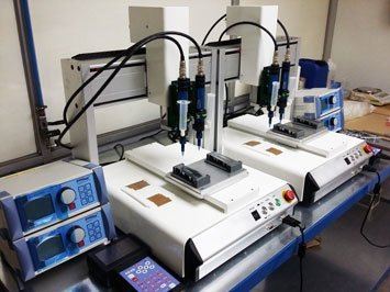 preeflow eco-PEN300 1 component dispenser and eco-CONTROL EC200-K dispensing controller in a dispensing system for color application on emblems.